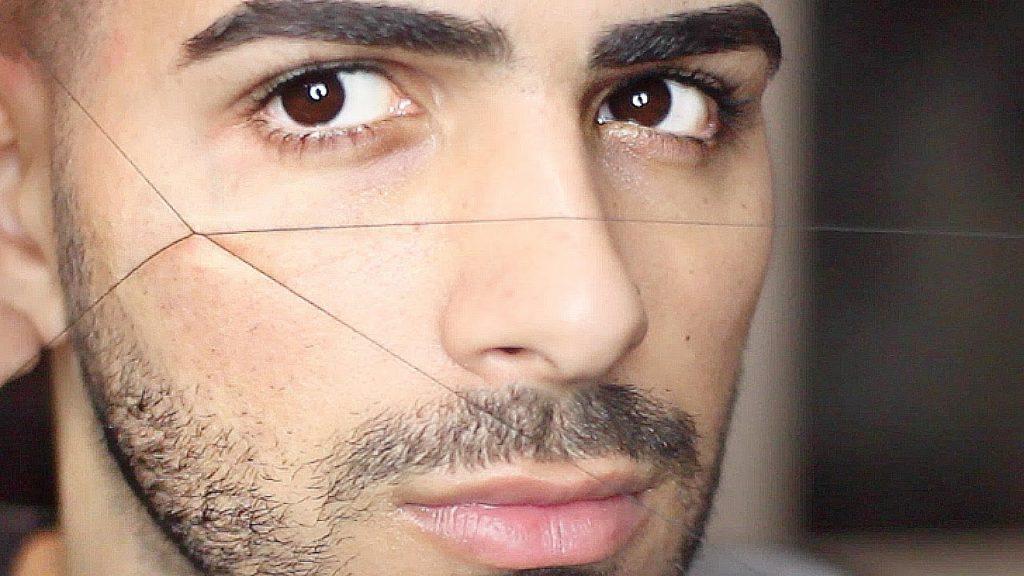 Man getting eyebrows threaded
